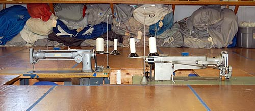 Photo of long arm sewing machines in machine pits.
