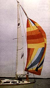 Photo of spinnaker being doused with a Chutescoop.